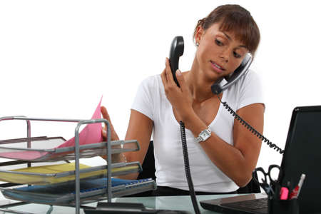 stressed business woman: An overwhelmed secretary  Stock Photo