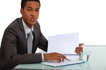 Afro-American businessman reading a report photo