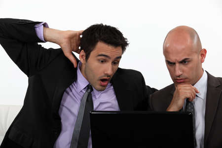 Two shocked office workers holding laptop Stock Photo - 17732416