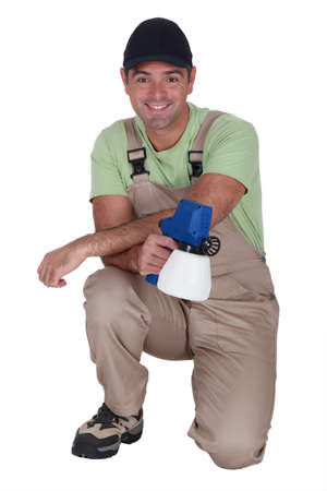 all smiles: plumber all smiles holding tool Stock Photo