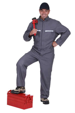 Man with a wrench and toolbox photo