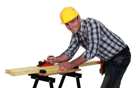 workbench: carpenter working on workbench