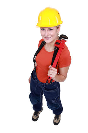 Woman holding a pipe wrench Stock Photo - 17732283