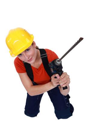 woman kneeling: Woman kneeling with punch Stock Photo