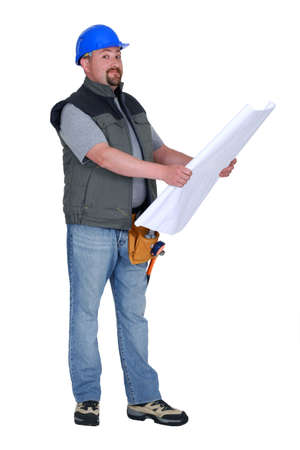 Builder looking at plans photo