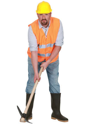 Bearded worker with pick-ax photo