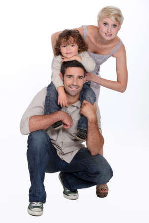 shoulder ride: Young family posing in a studio