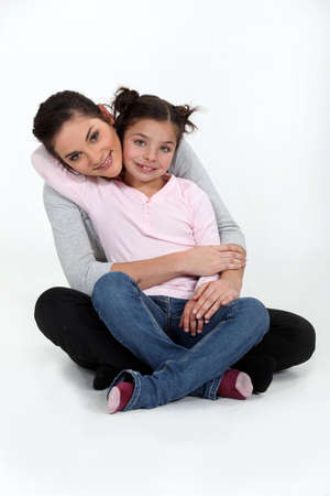 A mother and her daughter hugging  photo