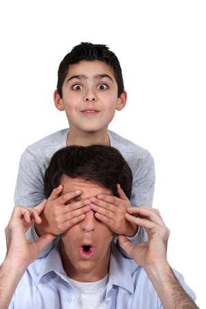paternal: Child covering parent