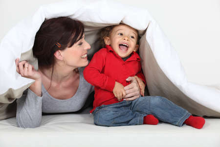 babysitter: Woman playing a hiding game Stock Photo
