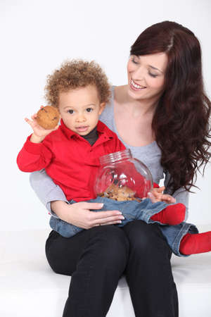 hand over: Mother and Child with cookie jar