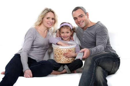 Family with popcorn photo