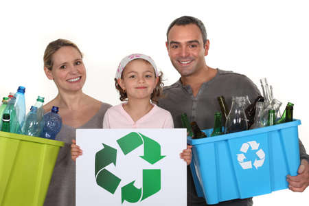Family recycling bottles photo