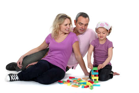 adroitness: Parents watching their daughter play with blocks