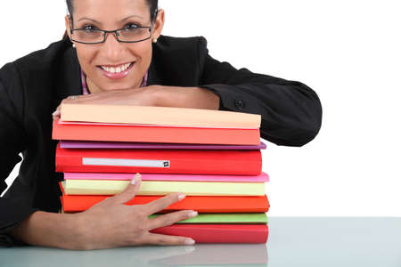 easy going: Secretary with a stack of folders Stock Photo