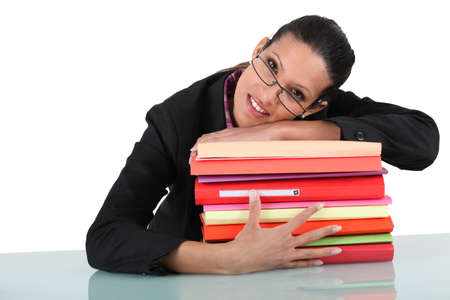 keep watch over: businesswoman holding a pile of folders