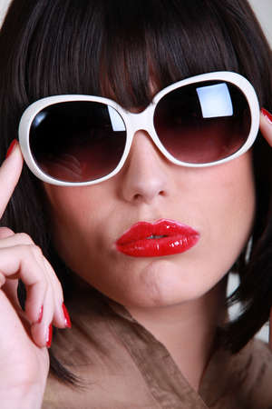 Woman wearing oversized sunglasses photo