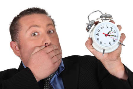hand on mouth: Man shocked to discover the time