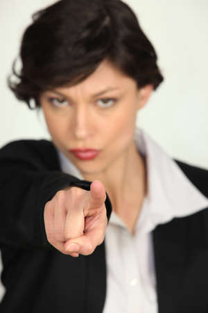 Strong businesswoman pointing at the camera Stock Photo - 17732476