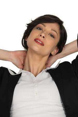 Businesswoman massaging her own neck photo