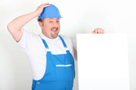 Worker holding up a blank sign Stock Photo - 17732462