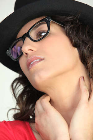 long neck: Woman in thick rimmed glasses