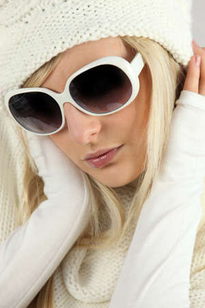show off: blonde heiress wearing glasses