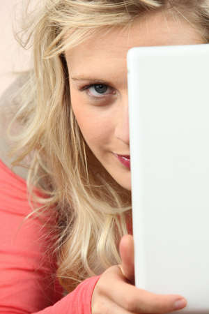 Blond hiding face behind laptop Stock Photo - 17732628