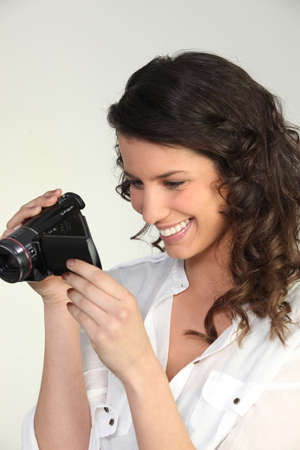 feature films: Woman using a camcorder