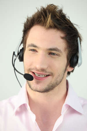 Attractive man speaking into a headset photo