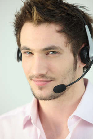 teleoperator: Portrait of a man with a headset Stock Photo