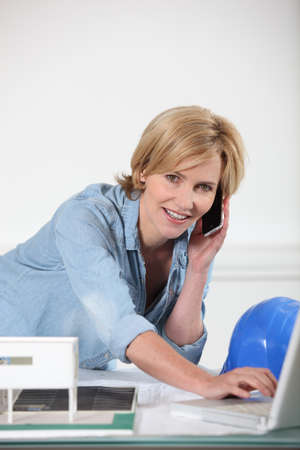 Female architect multi-tasking Stock Photo - 17732433