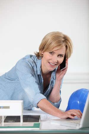 Female architect multi-tasking Stock Photo - 17732433