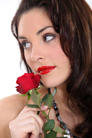 arousing: beautiful brunette with a red rose