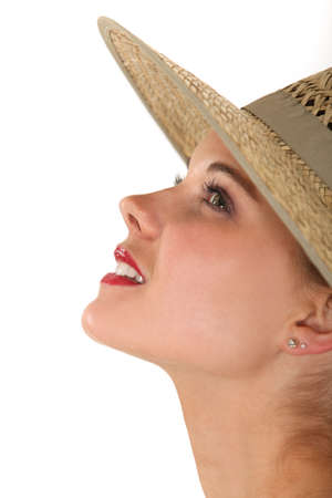 Profile of a woman in a straw hat photo