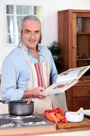 pantry: Elderly man cooking Stock Photo