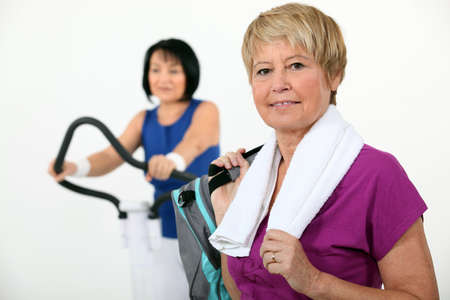 physical activity: Two middle-aged women at the gym Stock Photo