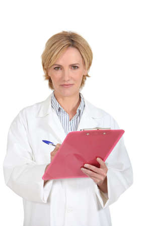 assessing: woman doctor taking notes