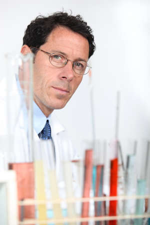 search results: Chemist with rack of test tubes