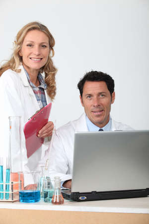 Male and female colleagues in laboratory Stock Photo - 17732857