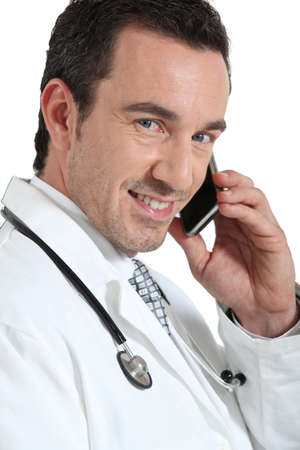 Doctor on phone smiling photo