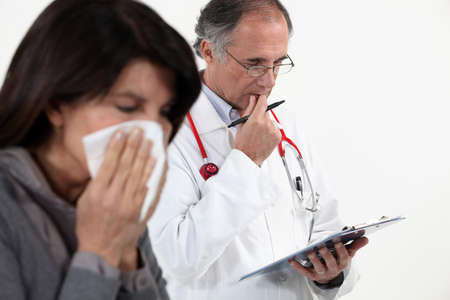 diagnosing: Doctor diagnosing a patient