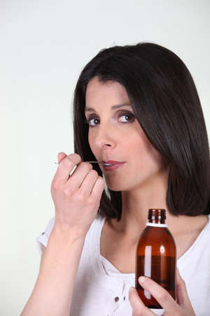 Brunette taking medication photo