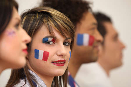europe closeup: Friends watching the French team play a soccer game