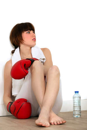Woman taking a break during a boxing session photo