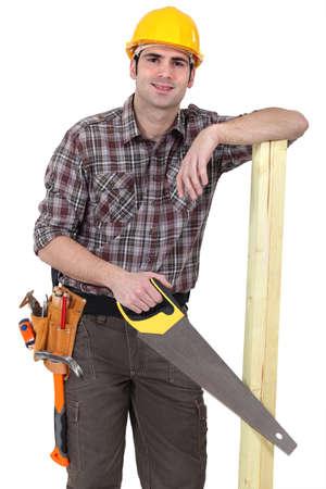 handsaw: Constructor con la madera y el serrucho Foto de archivo