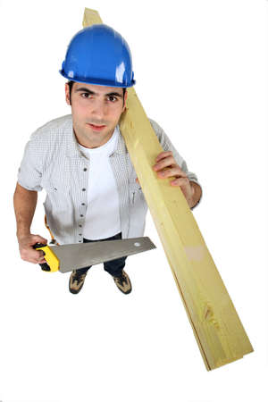 Tradesman holding planks of wood photo