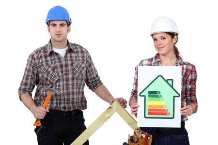 Couple stood with energy rating Stock Photo - 17904132