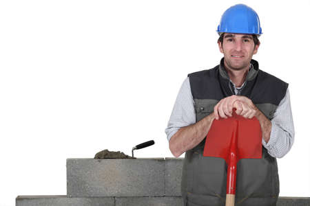 stonemasonry: Stonemason standing proudly next to his work Stock Photo