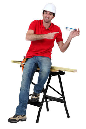 portrait of high-spirited carpenter showing protective goggles Stock Photo - 17904072